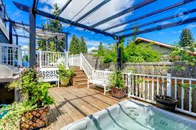 walkout deck with jacuzzi and pergola patio area with barbecue