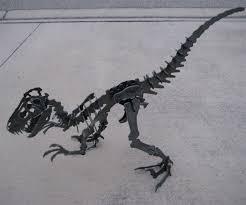 steel velociraptor puzzle dudeiwantthat