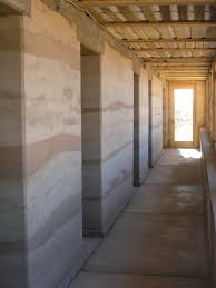 beautiful example of rammed earth also see banded plaster rammed