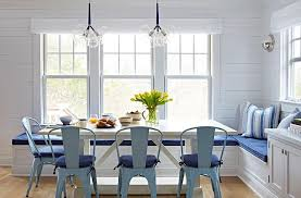 Beachy Dining Room by Beach Bungalow Dining Room With Blue Tolix Chairs And White