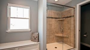 bathrooms harlow builders inc shower with ceramic tile and separate built in bench