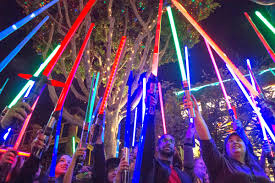 fan organizes lightsaber tribute to carrie fisher in downtown disney