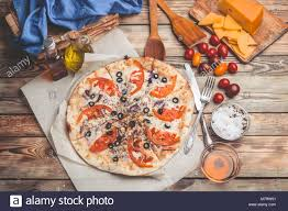 composition cuisine pizza margarita on thin crust food composition on a wooden stock