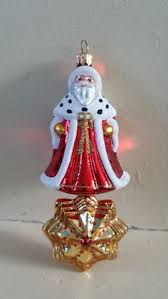 blown glass santa claus in a row boat christmas ornament made in