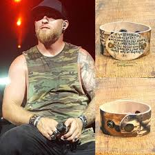 brantley gilbert earrings second amendment camo leather cuff on stage with brantley gilbert