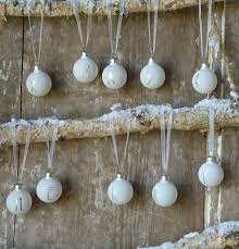 a set of white merry mini glass baubles by letteroom