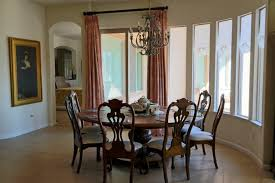 dining room gorgeous chandelier above classic table and luxurious