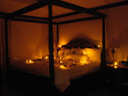 romantic candle lighting by bed warm and romantic honeymoon bed