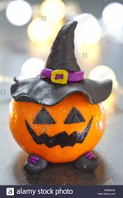 funny halloween pumpkin tangerine with black witches hat stock