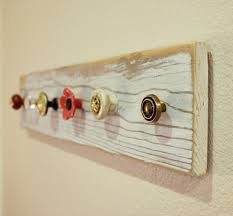 storage knob displays in pinks red coral and shabby chic wood