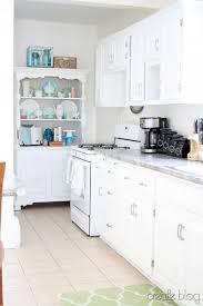 remodelaholic kitchen renovation updating knotty pine cabinets
