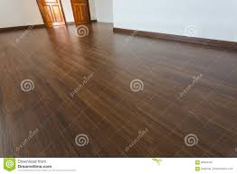 empty room white mortar wall background and wood laminate floor