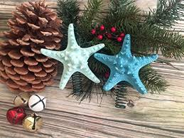 this colorful topper is perfect for small christmas trees tree