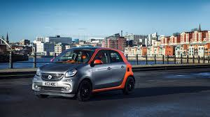 renault twizy vs smart fortwo smart forfour 1 0 2015 review by car magazine