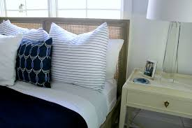 blue and white master bedroom with stripes and nautical accents