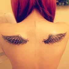 black and white ink wings on back by cally jo tattoos on