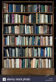 high resolution image of books on a bookshelf on a black