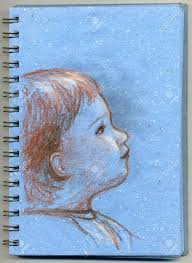 cute profile of baby hand made sketch drawn on blue notepad
