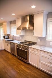 granite countertop with white cabinets backsplash for santa