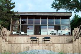 photo 9 of 10 in a respectfully renovated modern beach house on
