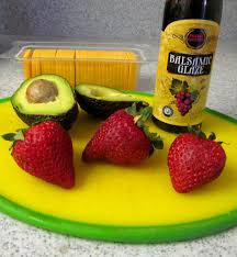strawberry avocado sunflower seed salad with strawberry balsamic