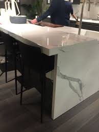 modern kitchen island ideas that reinvent a classic white marble kitchen island and stools under