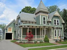 soft green paint exterior color with curvy roof for traditional