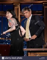 margaret cho left shows off her tattoos to host craig ferguson