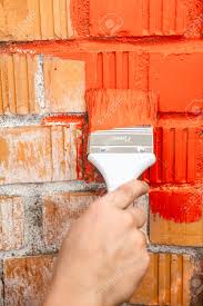 orange brick wall painted with red colour stock photo picture and