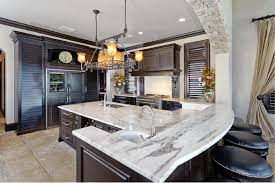 Mini Pendant Lights Over Kitchen Island by Elegant Kitchen Furnished With Dark Wood Cabinets And Using