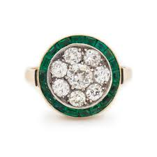 art deco diamond and green emerald target cluster ring