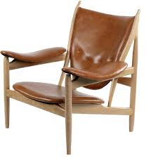 nyekoncept 445549 arne chair in burnt orange leather on mid