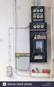 old fuse box with an electricity meter and electrical wiring on a