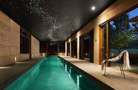 indoor basement pool pool asian with contemporary furniture