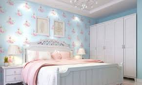 perfect light blue wall and white furniture in bedroom with pink