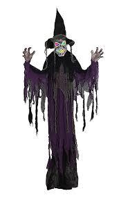 7 haunting witch door decorations for halloween