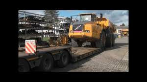 used volvo dump truck used volvo dump truck suppliers and loading of volvo dumper a 40 on low bed trailer youtube