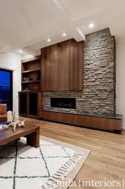 Fireplace Wall Tile by Large Plank Tile That Looks Like Hardwood On A Fireplace Feature