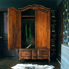 Armoire Furniture Plans Wardrobes Wood Stained Wardrobe In Bedroom With Four Post Bed