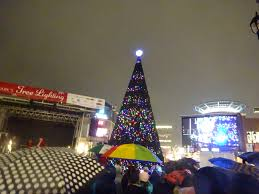 crocker park christmas tree lighting brightens a soggy night