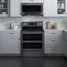 gray kitchen cabinets with black stainless steel appliances why are black stainless steel appliances so popular