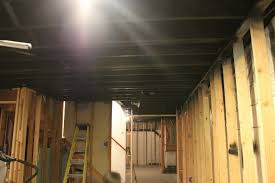 how to insulate a basement ceiling gap between bat wall and