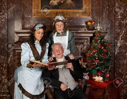 vintage christmas scene of a victorian family singing christmas