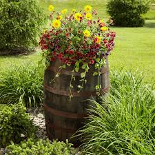 beautiful whiskey barrel planter or plant stand love this look
