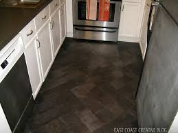 dark brown wood floor wood kitchen counter along with dark