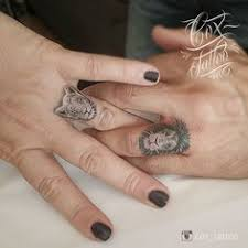 finger tattoo lioness pin by tattoopictures org on finger tattoos pinterest grey