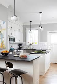small kitchen layout white island dark countertop black stools
