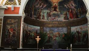vivid murals line church s walls display religious history the a mural entitled the
