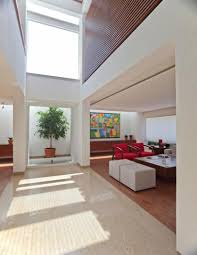 Decorating Ideas For High Ceiling Living Rooms Living Room Living Room With High Ceiling And Skylight Roof