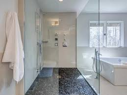 modern bathroom with freestanding tub and walk in shower featured
